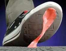 pink gum stuck to the bottom of a sneaker